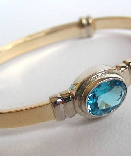Solid Gold Baby Bracelet With Blue Topaz