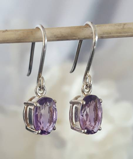 Claw set sterling silver amethyst earrings