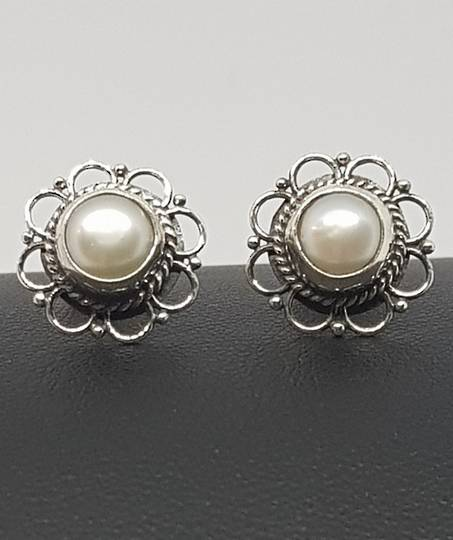 White pearl stud earrings with detailed silver frames