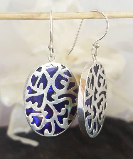 Purple paua shell silver earrings - ornate carved front