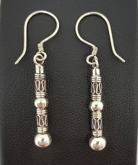 Long silver earrings with stunning designs