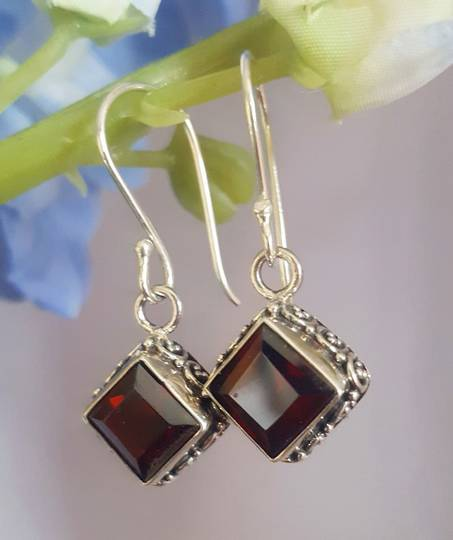 Sterling silver garnet earrings with filigree detailing