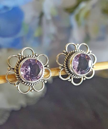 Sterling silver flower stud earrings with purple stone