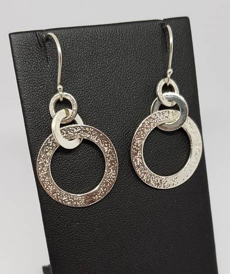 Silver hoop earrings with hammered detail