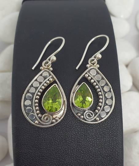 Silver peridot earrings in open teardrop shape