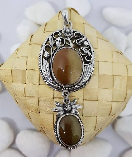 Silver pendant with brown gemstones