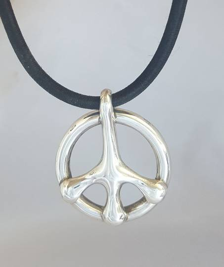 Silver peace sign pendant on black rubber cord