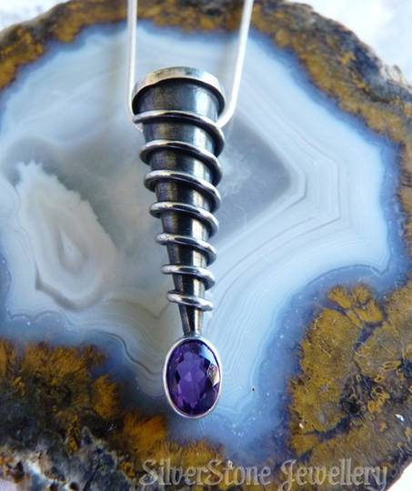 Unique, designer pendant, spiraled silver with amethyst