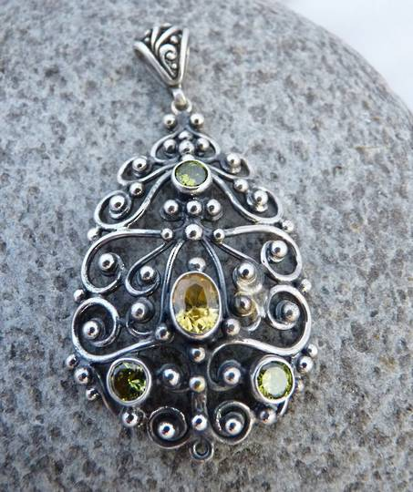 Romantic filigree silver pendant with green/gold gemstones