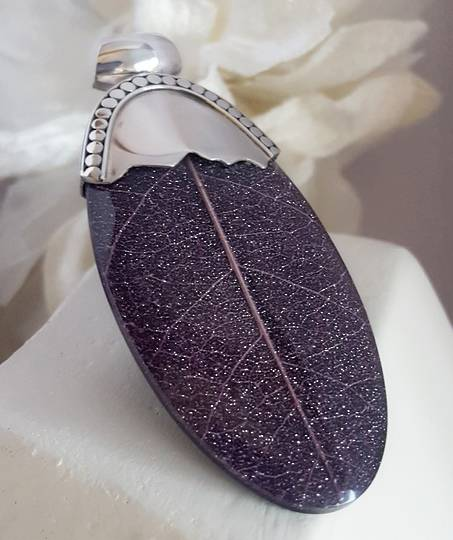 Elongated oval deep purple pendant made from skeleton leaf