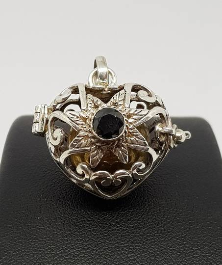 Silver filigree harmony ball pendant with black onyx
