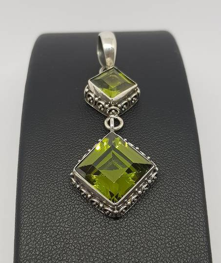 Double hanging silver peridot pendant with filigree frame