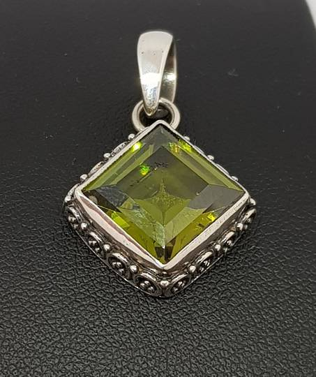 Silver peridot pendant with filigree frame