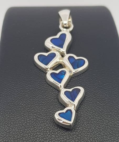 Dyed blue paua shell hearts pendant