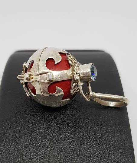 Silver meditation ball with red bell ball