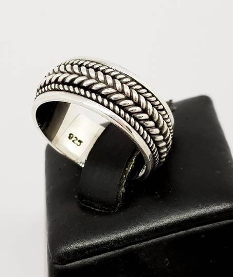 Silver ring with plaited detail in the band