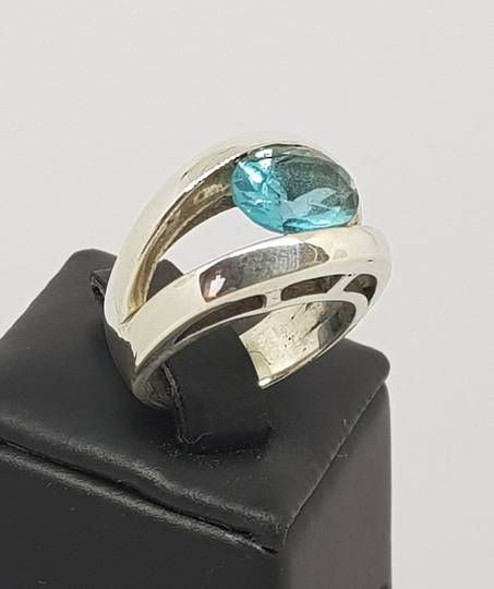 Sterling silver tension set blue topaz ring