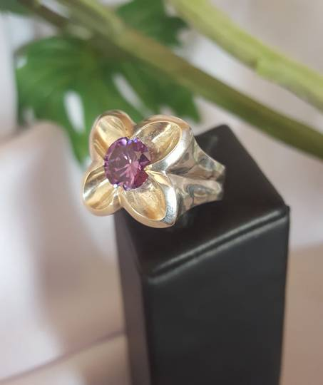 Silver flower ring with sparkling purple stone