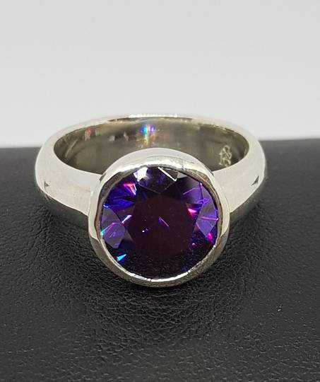 Sterling silver ring with sparkling synthetic amethyst