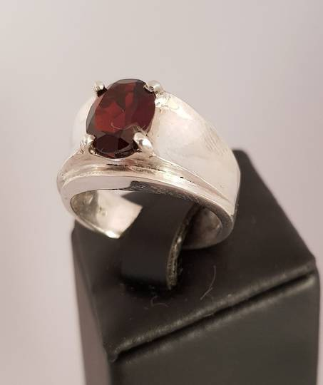 Wide silver band ring with garnet gemstone