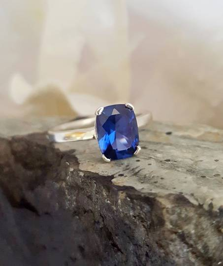 Cute little silver ring with synthetic sapphire