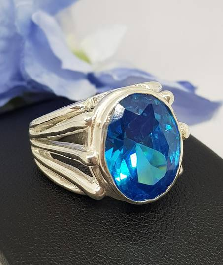 Fabulous weighty silver ring with large blue topaz gem
