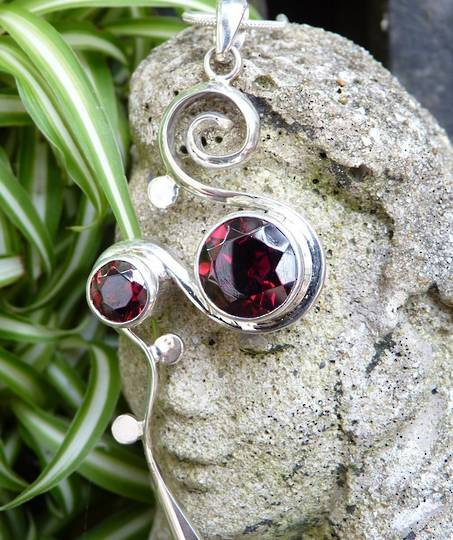 Two stone rubover setting silver garnet pendant