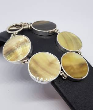 Gold toned shell and silver bracelet