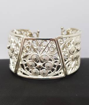 Chunky silver NZ made bracelet with carved flowers and swirls