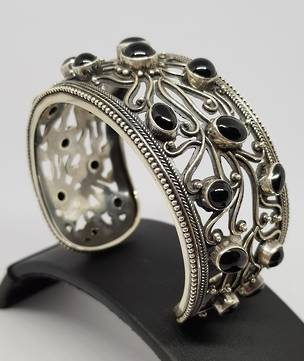 Wide silver ornate cuff bangle with black onyx