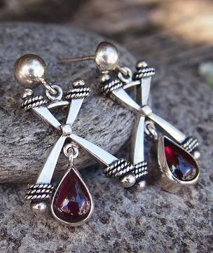 Silver designer earrings with natural cabochon garnet