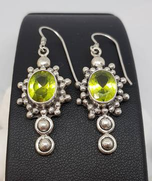 Large ornate silver peridot earrings with a gorgeous
