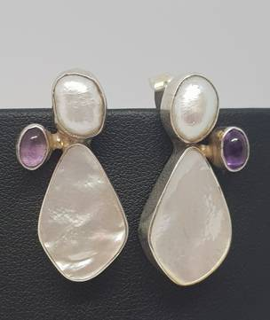 Mother of pearl earrings offset with amethyst