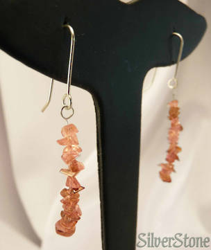 Pink tumbled gemstones threaded onto silver hook earrings