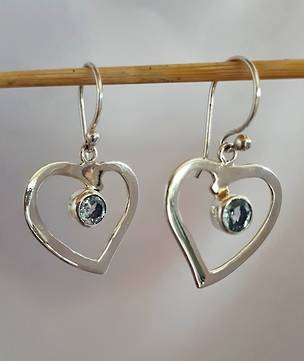 Silver hearts with blue topaz stone