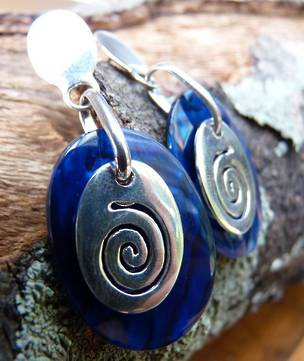 Nz paua shell earrings with koru design