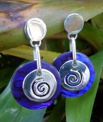 Purple paua shell earrings with koru detail