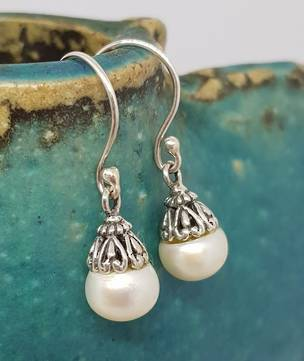 Classic pearl drop earrings with silver detail