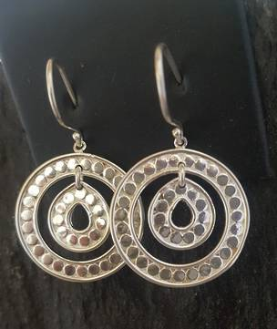Spiral hoop earrings with dotted pattern