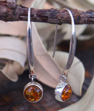 Silver amber earrings on long stems
