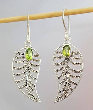 Silver lace leaf earrings with peridot