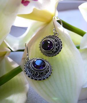 Silver earrings with purple stone