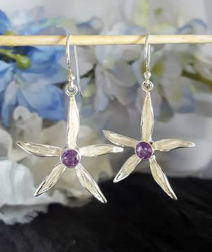 Silver daisy earrings with purple gemstone