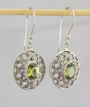 Oval silver peridot earrings with filigree framing