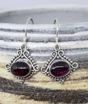 Sterling silver garnet earrings in decorative frame