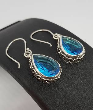 Dazzling blue topaz teardrop silver hook earrings