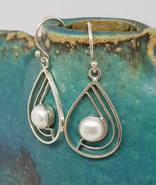 Teardrop white pearl earrings with open silver frame