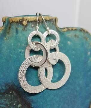 Silver hoop earrings with hammered detail