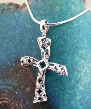 Silver cross pendant - detailed, off centre