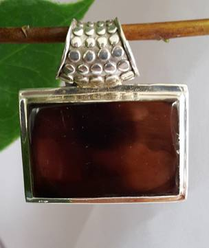 Brown shell pendant with heavy detailed bale